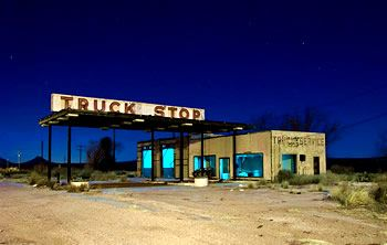 picture of a truck stop at night