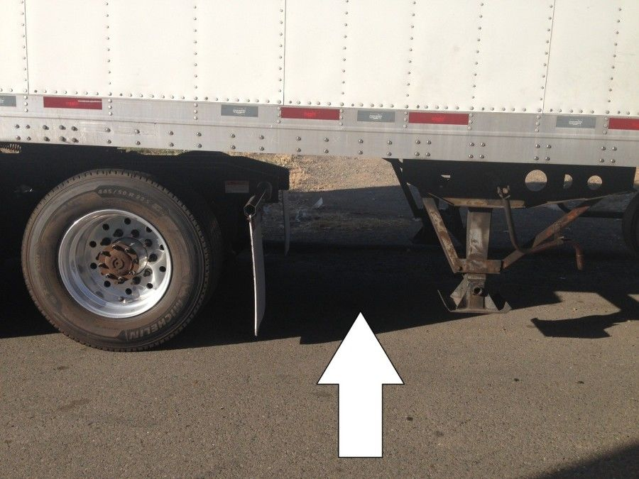 truck driver's pretrip inspection clearance between mudflap and landing gear