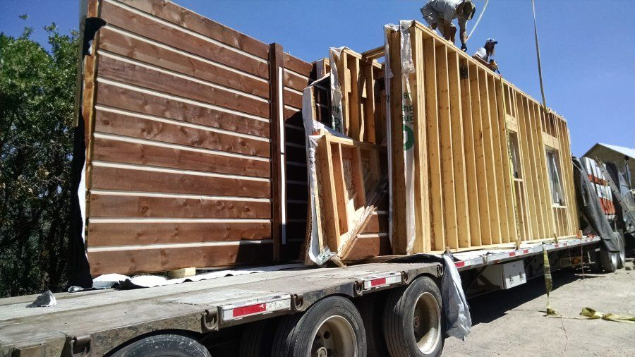 construction house framing loaded on flatbed