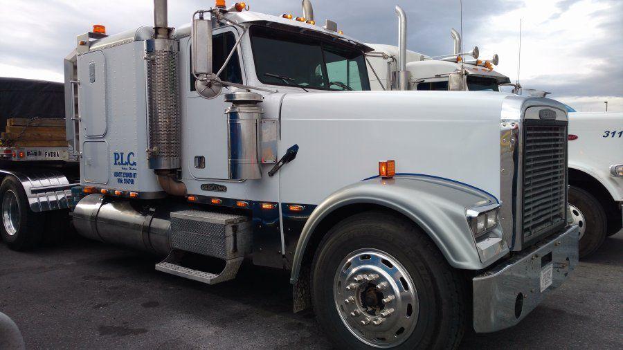 1996 white Freightliner FLD120 semi-truck