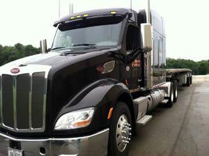 TMC Transportation truck parked in parking lot
