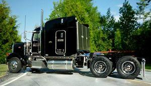 TMC Transportation truck on the road