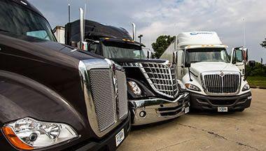 Celadon trucks in the parking lot