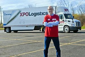 XPO CEO and truck in parking lot