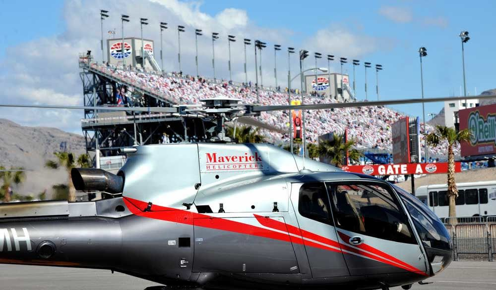 Maverick Transportation helicopter at a racetrack