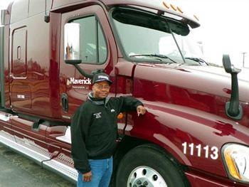 Maverick Transportation driver next to his truck
