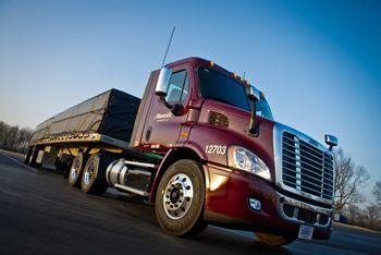 Maverick Transportation flatbed truck in parking lot