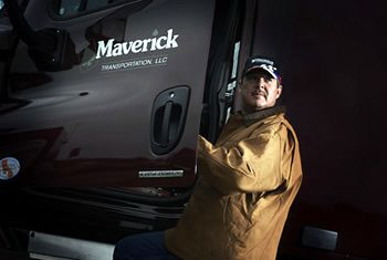 Maverick Transportation driver getting in his truck